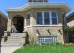 Foreclosed Home in Chicago 60634 N MERRIMAC AVE - Property ID: 2497411547
