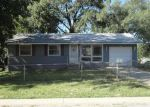 Foreclosed Home in Kansas City 64129 E 52ND ST - Property ID: 2831350963