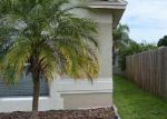 Foreclosed Home in Tampa 33624 RAMBLING ROSE PL - Property ID: 2887701109