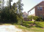 Foreclosed Home in Magnolia 77354 HIDDEN LAKE CT - Property ID: 3210531312
