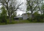 Foreclosed Home in Highlands 77562 N BATTLEBELL RD - Property ID: 3233265227