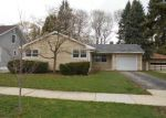 Foreclosed Home in Elgin 60123 N COMMONWEALTH AVE - Property ID: 3279010296