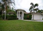 Foreclosed Home in Port Saint Lucie 34953 SW MILLIKIN AVE - Property ID: 3377207580