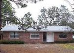 Foreclosed Home in Oak Island 28465 NW 9TH ST - Property ID: 3396938296