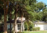 Foreclosed Home in Jacksonville 32246 CARRIAGE LAMP DR - Property ID: 3458013336