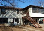 Foreclosed Home in Independence 64056 E TRUMAN RD - Property ID: 3586591107