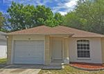 Foreclosed Home in Tampa 33617 WILDWOOD OAK DR - Property ID: 3679646579