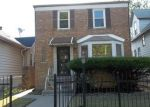 Foreclosed Home in Chicago 60628 S PARNELL AVE - Property ID: 3770725908