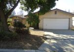 Foreclosed Home in Fresno 93722 W CALIMYRNA AVE - Property ID: 3861716304