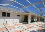 Foreclosed Home in Cape Coral 33990 SE 3RD TER - Property ID: 3921588675