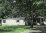 Foreclosed Home in Magnolia 77355 SEA TURTLE LN - Property ID: 3961074205