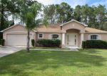 Foreclosed Home in Palm Coast 32164 REINHARDT LN - Property ID: 3991859856