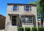 Foreclosed Home in Chicago 60628 S RHODES AVE - Property ID: 4005274103