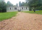 Foreclosed Home in Liberty 77575 BAKER CIR - Property ID: 4018198283