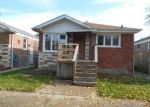 Foreclosed Home in Chicago 60628 S EBERHART AVE - Property ID: 4069180654