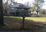 Foreclosed Home in Yulee 32097 CLYDE HIGGINBOTHAM RD - Property ID: 4107217377