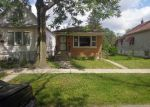 Foreclosed Home in Chicago 60628 E 119TH PL - Property ID: 4146154132