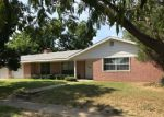 Foreclosed Home in Madill 73446 W TISHOMINGO ST - Property ID: 4202248984