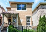 Foreclosed Home in Chicago 60619 S WOODLAWN AVE - Property ID: 4209737901