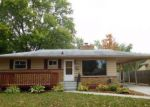 Foreclosed Home in Lansing 48910 E SYRINGA DR - Property ID: 4210340993