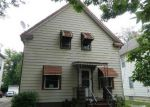 Foreclosed Home in Cleveland 44105 E 57TH ST - Property ID: 4219256373