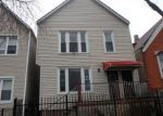 Foreclosed Home in Chicago 60619 S CHAMPLAIN AVE - Property ID: 4245540963