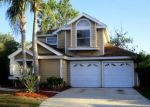 Foreclosed Home in Orlando 32825 CHURCHILL DOWNS CIR - Property ID: 4260803467