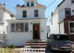 Short Sale in Hollis 11423 202ND ST - Property ID: 6292216654