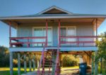 Short Sale in Oak Island 28465 E PELICAN DR - Property ID: 6301413221