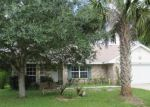 Short Sale in Palm Coast 32164 ROUND TREE DR - Property ID: 6304805332