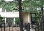 Foreclosed Home in Chicago 60639 N MULLIGAN AVE - Property ID: 4160918689