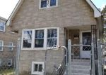 Foreclosed Home in Chicago 60639 N LEAMINGTON AVE - Property ID: 4266282975