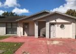 Foreclosed Home in Tampa 33615 ROUNDWOOD CT - Property ID: 4327972474