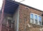 Foreclosed Home in Chicago 60619 S CHAMPLAIN AVE - Property ID: 4353953531