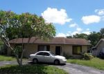 Short Sale in Pompano Beach 33068 SW 7TH PL - Property ID: 6324294748