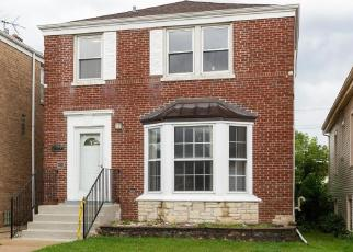Foreclosed Home in Chicago 60634 N MELVINA AVE - Property ID: 4419583496