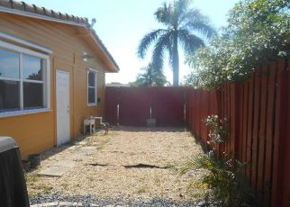 Short Sale in Pompano Beach 33064 NE 8TH TER - Property ID: 6330860405